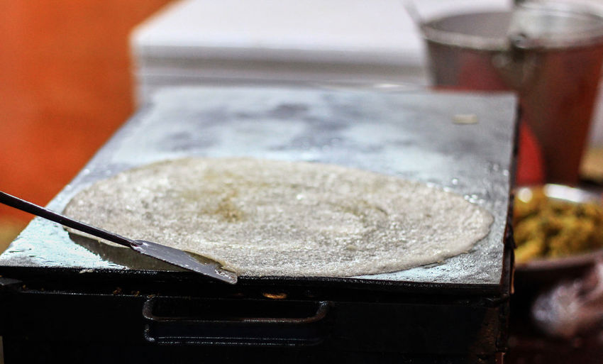 Close-up of dosa cooking pan in commercial kitchen