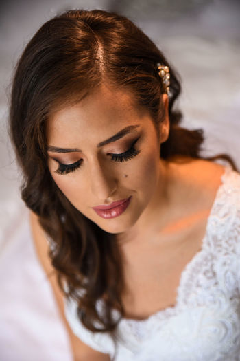 Close-up portrait of a young woman with bride makeup