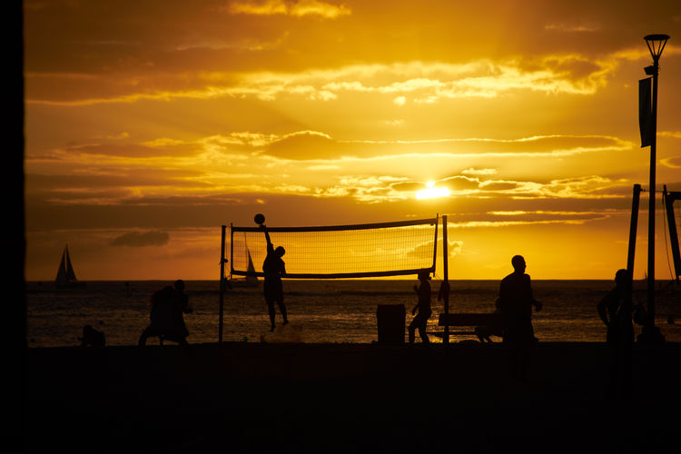 Beach Beach Volleyball Beautiful Beauty In Nature EyeEm Best Shots Golden Hour Horizon Over Water Horizontal Idyllic Lifestyles Men Nature Net - Sports Equipment Outdoors People Real People Sea Silhouette Sky Sport Sportsman Sunset Sunset_collection Volleyball - Sport My Year My View The Great Outdoors - 2017 EyeEm Awards Paint The Town Yellow