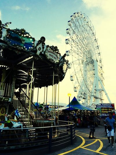 Amusement Park at Mall Mall Sm Mall Philippines EyeEmNewHere IPhoneography Captured Moment New Photography EyeEmNewHere EyeEm Selects Eyeemphotography Eyeem Philippines EyeEm Best Shots Enjoying Life Expressing Through Art Art Photography Art Photo Big Wheel Ride Carousel Horses Traveling Carnival Carnival