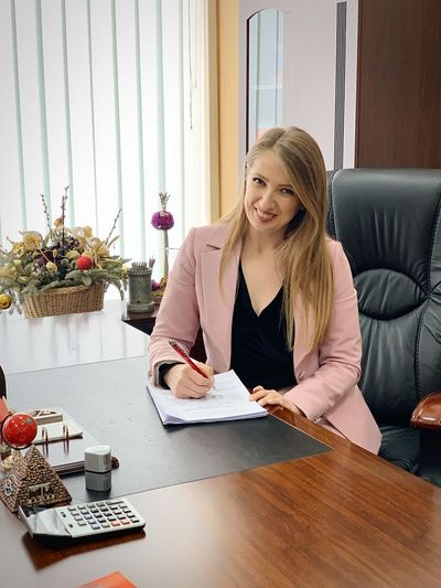 Office Girl Office Interior Office Worker Office Work IPhone XS Max Photography Professional Occupation Businesswoman 30-35 Years Old Blond Hair EyeEm Selects One Person Sitting Indoors  Women Furniture Table Young Adult Home Interior Young Women Casual Clothing Lifestyles Beautiful Woman Smiling Waist Up Hair Front View Real People Adult Hairstyle Blond Hair