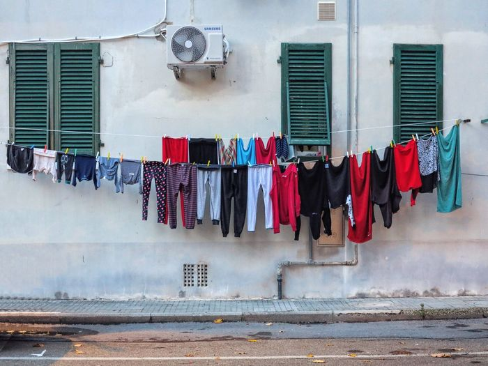 Clothes drying against wall