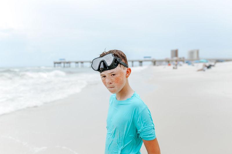 Boy standing on beach