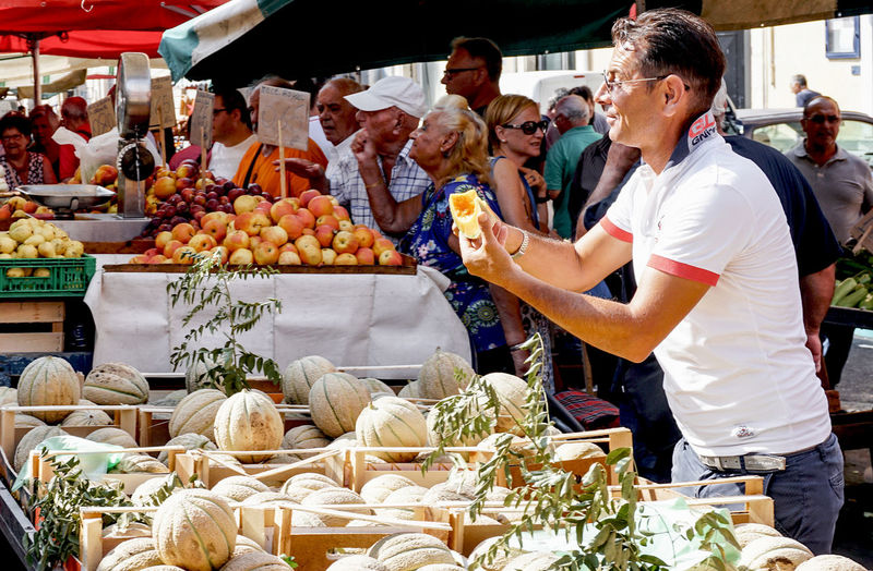 vendor at the market in Palermo, Sicily, Italy Streetphotography Street Photography Palermo Sicily Market Teasing Small Business Fruit Vegetable Food Food And Drink For Sale Consumerism Vendor