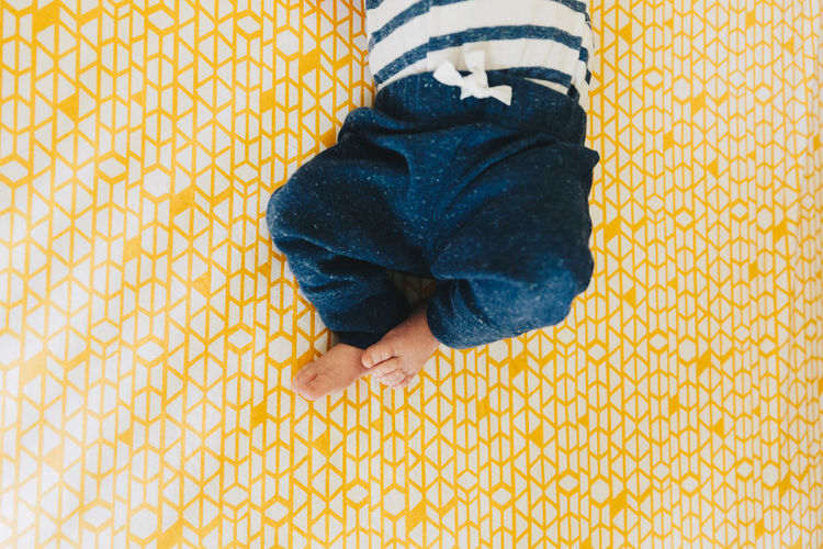 Cute Baby Legs in Yellow Crib Baby Bright Colors NewBorn Photography barefoot Blue Childhood Close-up Fresh Home Interior Human Leg Indoors  Infant Legs Lifestyles Low Section Minimalism Newborn One Person Pattern Real People Striped Style Sweatpants Yellow