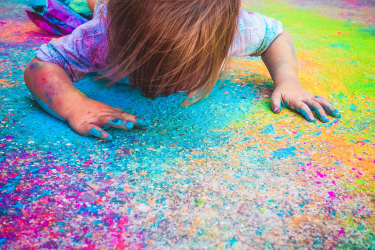 One Person Multi Colored Childhood Child Girls Offspring Leisure Activity Real People Art And Craft High Angle View Playing Fun Paint Creativity Casual Clothing Lifestyles Women Day Human Hand Innocence Messy Hairstyle
