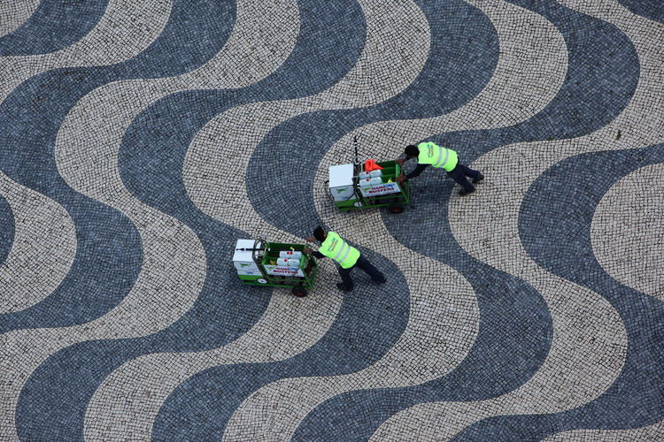 High angle view of two men cleaning floor