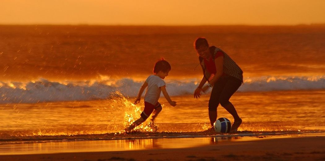 """Catch the Ball, Mom"" Sunset Dialogue The EyeEm Facebook Cover Challenge Life Is A Beach RePicture Giving Love Is In The Air Orange By Motorola"
