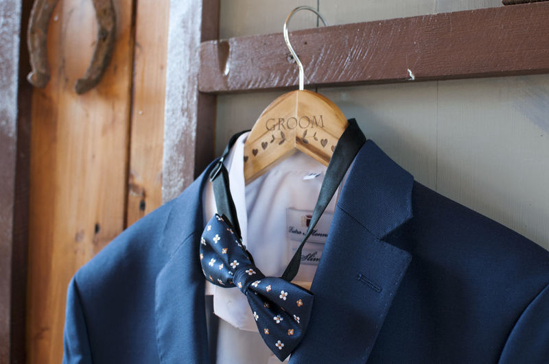 groom Celebration Dress Groom Wedding Business Button Down Shirt Close-up Clothing Coathanger Fashion Hanging Hook Indoors  Menswear Necktie No People Occupation Preparation  Retail  Small Business Store Suit Wall - Building Feature Well-dressed Wood - Material