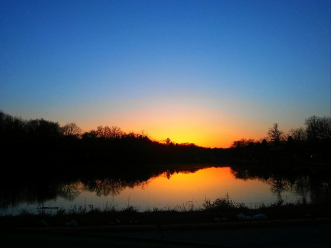 """""""Can't wait for warmer weather!! Sunset April 1st. Check This Out Pretty Orange Color Cold Iowa Life Riverbank River River View Water Sky Reflection Tranquility Tree Tranquil Scene Sunset Landscape"""