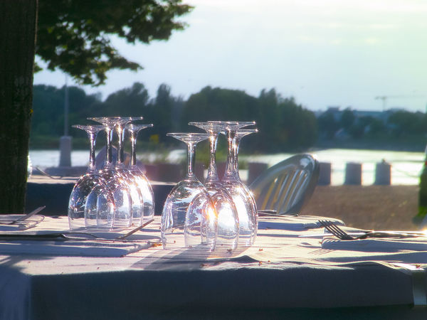 Empty glasses. 2010. France Reflection Absence Business Day Drinking Glass Eating Utensil Empty Food And Drink Furniture Glass Glass - Material Household Equipment Luxury Nature No People Outdoors Place Setting Plate Restaurant Seat Setting Sunlight Table Tablecloth