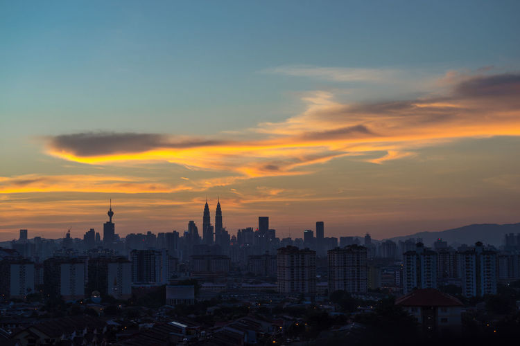 View of downtown Kuala Lumpur during majestic sunset Architecture Building Exterior Downtown District Horizon Kuala Lumpur Malaysia  Kuala Lumpur Tower Kuala Lumpur Twin Tower Petronas Sunset Urban Landscape