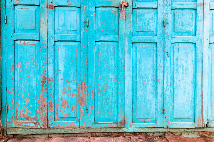 Old house with vintage wooden blue cyan door and gray cement wall. Vintage blue cyan doors concept use for background. Mediterranean  Blue Cyan Green Grün Blau Türkis Decorative Doors With Stories Vintage Wallpaper Wooden House Wooden Texture