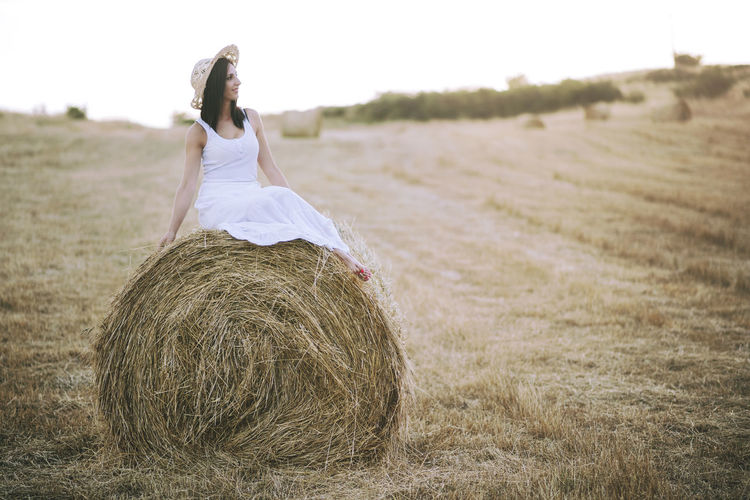 Happiness Happy Lifestyle Portrait Of A Woman Woman Agriculture Bale  Beautiful Woman Farm Field Girl Landscape Leisure Activity Nature Portrait Rural Scene Smile Smiling Straw Tranquility Woman Portrait Young Women