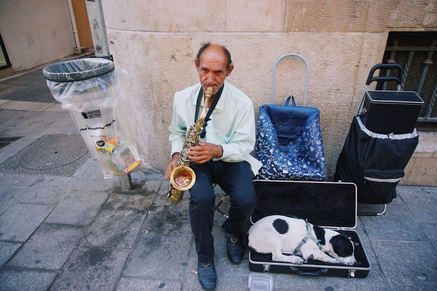 Streetphotography Street Photography Street Musicians Music Musician Pet Saxofone🎷 Saxophone Play EyEmNewHere EyeEmNewHere EyeEmNewHere The Week On EyeEm Connected By Travel Small Business Heroes