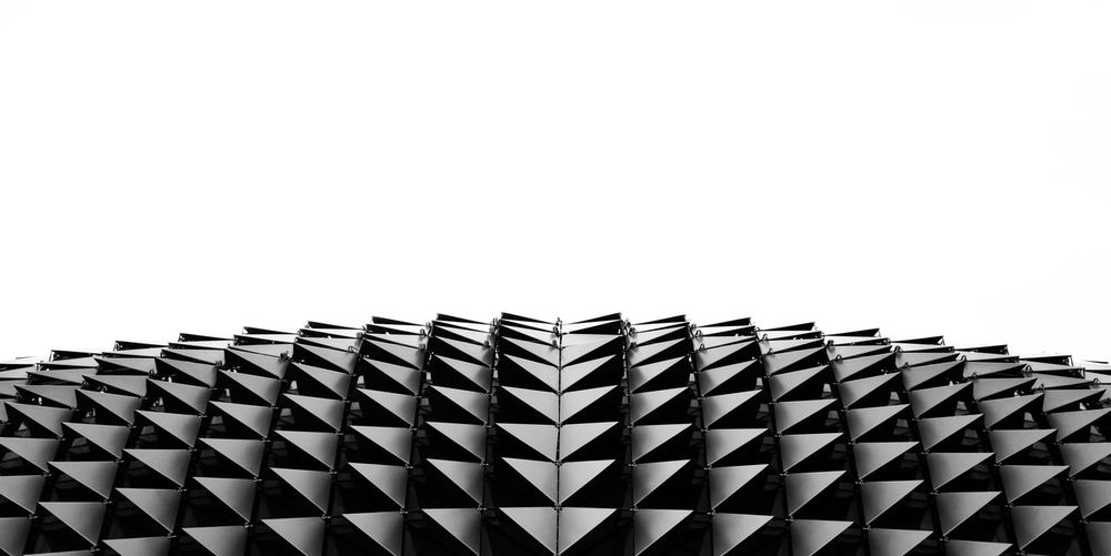 Durian ? Repetition Pattern Repetition EyeEm Best Shots - Black + White Jagged Symmetry Design Building Exterior Building Black And White Blackandwhite Sharp Edges Sky Built Structure Architecture Copy Space Clear Sky Low Angle View Building Exterior No People Pattern Day Repetition In A Row Side By Side Design City Modern Office Building Exterior The Architect - 2018 EyeEm Awards