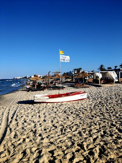 Travel Destinations Tourist Resort Lifestyles Summer Sand Beach Relaxation Vacations Personal Perspective Yellow Flag