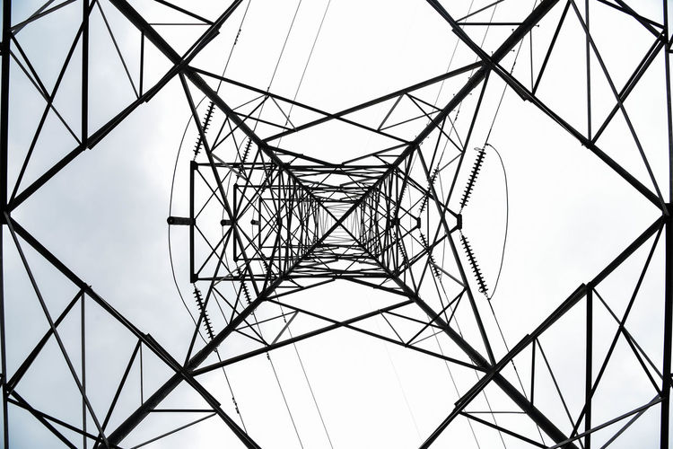 Pattern. Sky Electricity  Electricity Pylon Cable No People Architecture Nature Clear Sky Pattern Fuel And Power Generation Low Angle View Power Supply Connection Technology Built Structure Power Line  Directly Below Complexity Metal Day Outdoors Iron - Metal Girder Electrical Equipment Alloy EyeEmNewHere