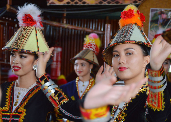 "Penampang, Sabah Malaysia.May 30, 2016 : Kadazan papar ladies of Sabah Borneo in traditional costume dancing the ""Sazau"" Papar. Pesta Kaamatan or Harvest Festival is a major event for the Kadazandusun of Sabah. Adult Adults Only Colorful Costume Culture And Tradition Cultures Dance Day Harvest Festival Headdress Headwear Indoors  Kaamatan Lifestyles Malaysia Truly Asia Malaysian People Performance Real People Sabah Sumazau Traditional Clothing Traditional Culture Traditional Dancing Young Adult"