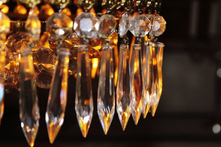 Close-up of illuminated candles in glass