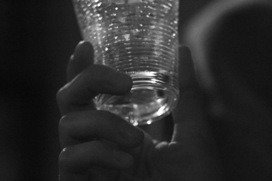 Black And White Black Background Bnw Close-up Day Grainy High On Iso Holding Human Body Part Human Hand Indoors  One Person People Vernisage Cup Plastic Cup Water Fresh Wine Drink