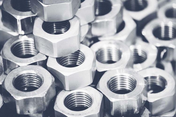 Full Frame Shot Of Metallic Nuts