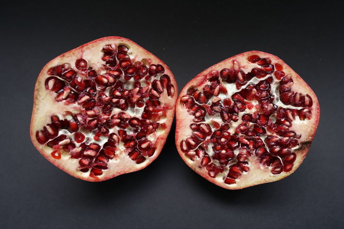 Bio Black Background Close-up Cross Section Day Food Food And Drink Freshness Fruit Granatapfel Gray Background Halved Healthy Eating Indoors  No People Obst Pomegranate Pomegranate Seed Red Seed Still Life Studio Shot