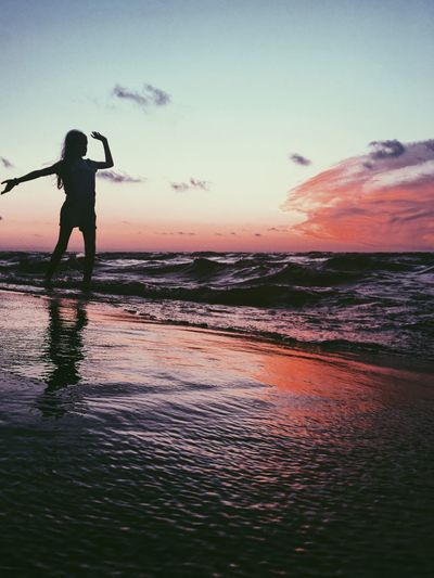 Dancing with the waves Water Sky Sunset Real People Sea Beauty In Nature The Traveler - 2018 EyeEm Awards One Person Beach Silhouette Reflection Horizon Over Water Nature Leisure Activity