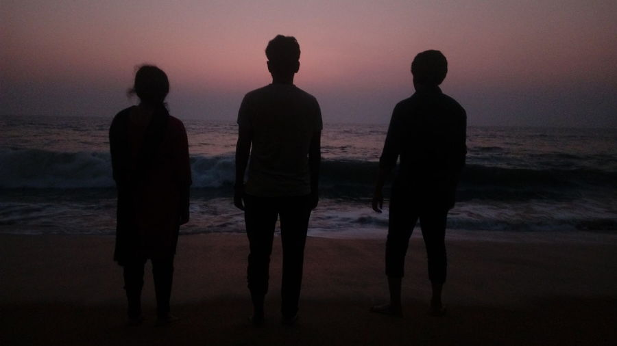three people standing in front of me facing the Sea ?........ I can't see the Sea properly ....😂😂😂😂😂😂😂😂 Focus On Foreground EyeEm Selects Mobilephotography The Purist (no Edit, No Filter) Enchanting India Simple Quiet Love Photography Color Of Life Girl Boy ASIA Low Light Simple Taking Photos Silhouette Beach Sunset Small Group Of People Reflection Full Length Standing Togetherness People Night Sea Adult Water Outdoors Friendship Sky An Eye For Travel
