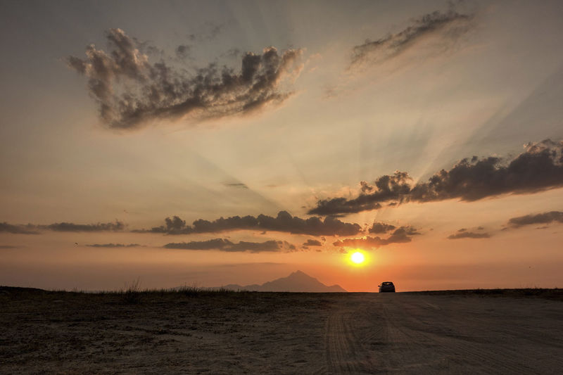 Driving to the Sun. Driving Sand Road To The Mountains Travel Travelling Trip Cloud - Sky Dawn Drive Landscape Scenics Sunrise Sunset To The Sun Trace Traces Traces In The Sand Tranquil Scene Tranquility Tyre Trace Tyre Traces Wheeling Lost In The Landscape