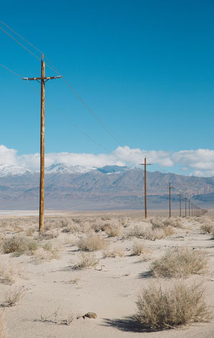 Arid Climate Blue Sky CA-190 Cable Connection Coso Day Death Valley Desert Electricity  Electricity Pylon Fuel And Power Generation Landscape Mountains Nature Nature No People Olancha Outdoors Power Line  Road Roadtrip Sand Sky Telephone Line Gridlove