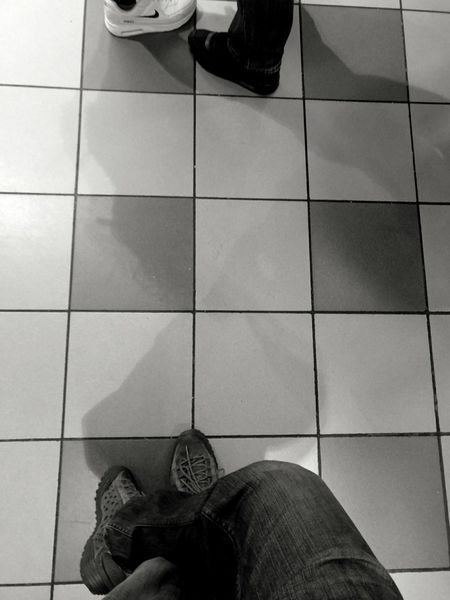 Human Leg Low Section Tiled Floor Personal Perspective Human Body Part Standing High Angle View Adults Only People Indoors  Leg Adult Blackandwhite Blackandwhite Photography Waiting For Food Bored Bored As Hell Nofood Yet Aaaaaaaaaaah....!!!