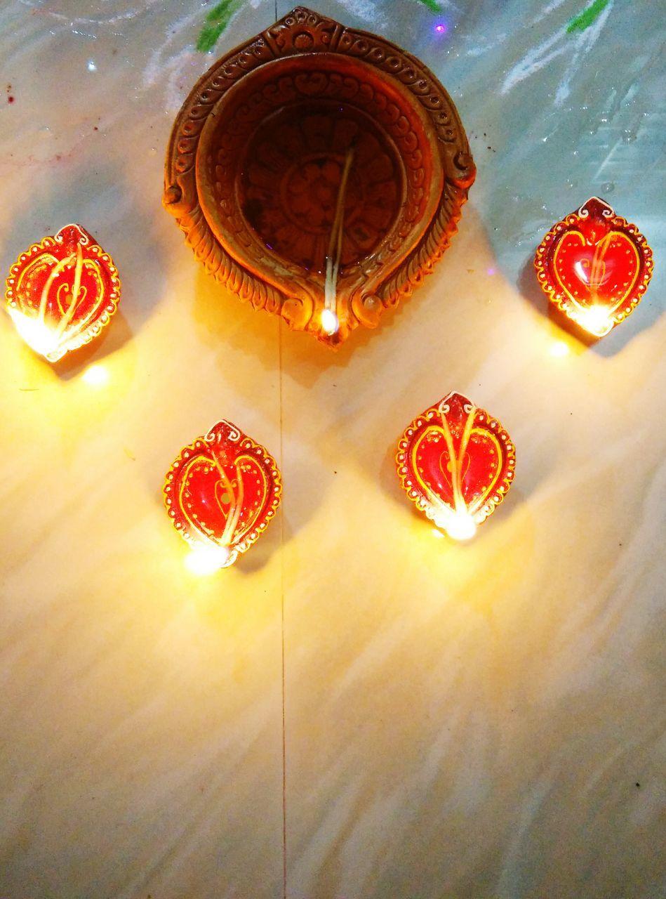 lighting equipment, no people, illuminated, indoors, diya - oil lamp, red, celebration, diwali, oil lamp, close-up, day