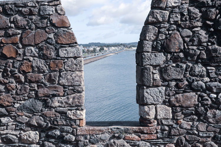 Looking out from a castle wall to the sea at carrickfergus, northern ireland