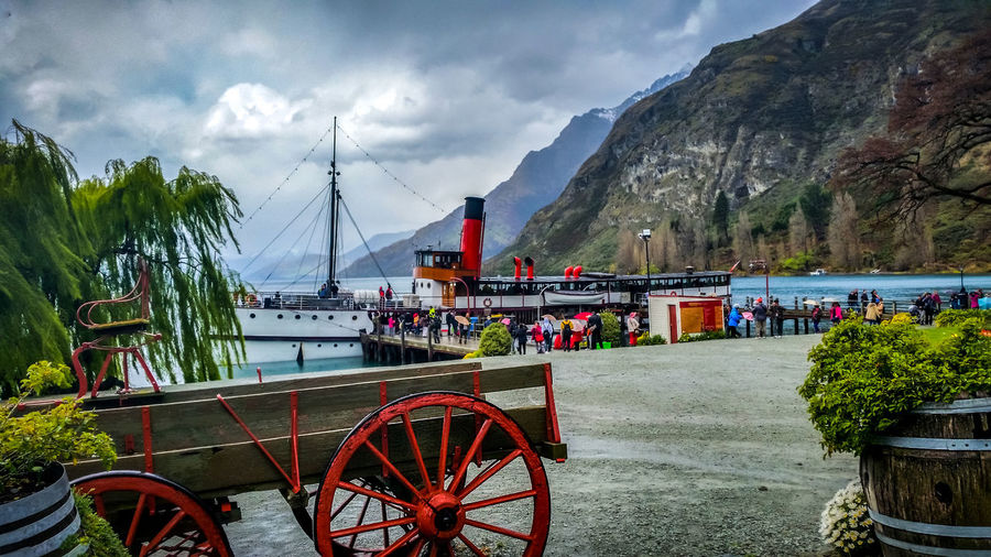 Earnslaw TSS Earnslaw Unrecognizable People Bay Beauty In Nature Built Structure Cart Cloud - Sky Group Of People Incidental People Mode Of Transportation Mountain Mountain Range Nature Nautical Vessel Outdoors Passengers Steam Ship Steamship Transportation Travel Travellers Tree Walter Peak Wheel