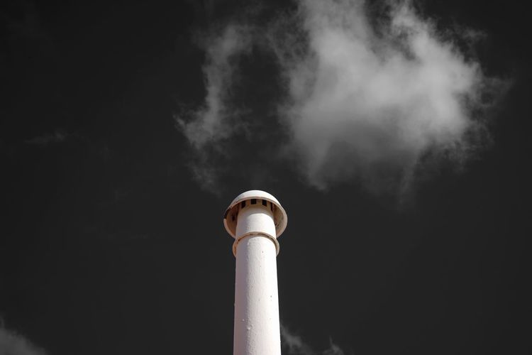Smoke - Physical Structure Air Pollution Smoke Stack Emitting Pollution Chimney Industry Environmental Issues Factory Steam Fumes Building Exterior Built Structure Low Angle View Architecture No People Outdoors Day Sky Global Warming