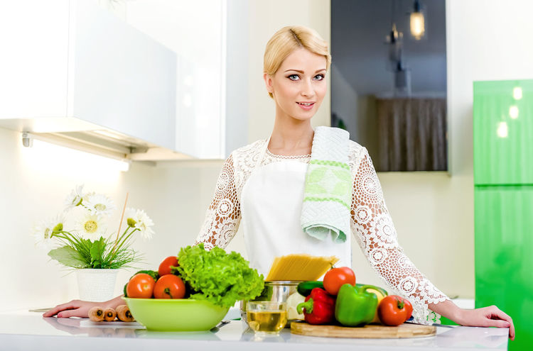 Young woman cooking. Healthy Food. Dieting Concept. Healthy Lifestyle. Cooking At Home. Attractive Beautiful Woman Blond Hair Caucasian Cooking Diet Dieting Dinner Domestic Kitchen Domestic Room Food Preparation Healthy Eating Healthy Lifestyle Indoors  Indoors  Kitchen One Person Paprika Preparation  Spaghetti Tomato Vegetables Vegetarian Vegetarian Food Woman
