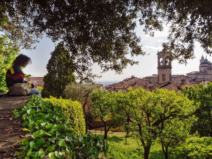 Siege // Bergamo Alta // Apr'17 Tree Green Color Outdoors Nature Growth Agriculture Day Adult People Adults Only Only Women Beauty In Nature Sky One Person Freshness Bergamo Italy Streetphotography Candid