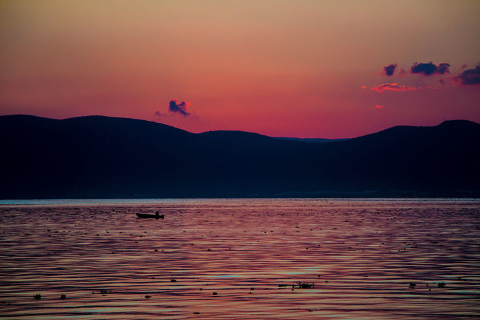 rED Mexico Red Sunset_collection Beauty In Nature Beutiful  Black Boat Day Mountain Mountain Range Nature No People Outdoors Scenics Sky Sunset Tranquility Water Waterfront