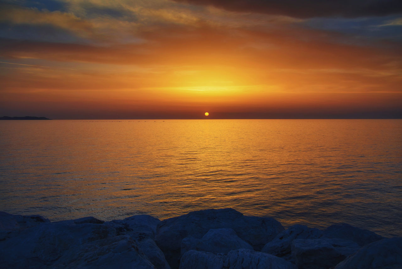 sunset, beauty in nature, sea, scenics, tranquil scene, nature, tranquility, water, orange color, sun, horizon over water, sky, idyllic, no people, outdoors, reflection, beach, cloud - sky, day