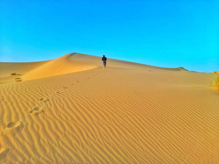 Walking on sand dunes on desert