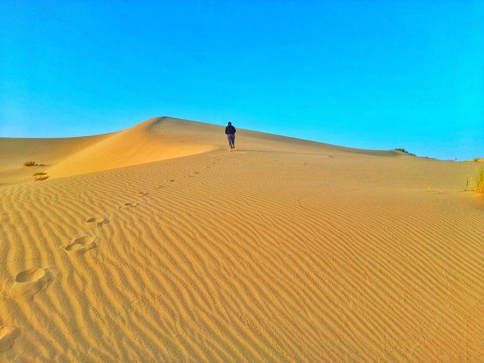 Walking on sand dunes on desert
