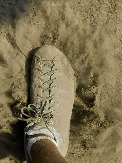 Close-up Day Dust Dust Cloud Foot No People Outdoors Shoe Shoe Sport Tanzania