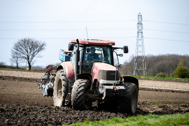 Tractor on field against sky
