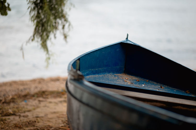 Close-up of boat on beach