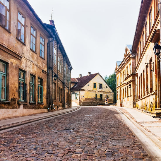 Historic buildings on Baznica Iela, Kuldiga. Latvia Architecture Building Building Exterior Built Structure Car City City Life City Street Culture Day Exterior Historic History Incidental People Kuldiga Latvia Narrow Outdoors Residential Building Residential Structure Street The Way Forward
