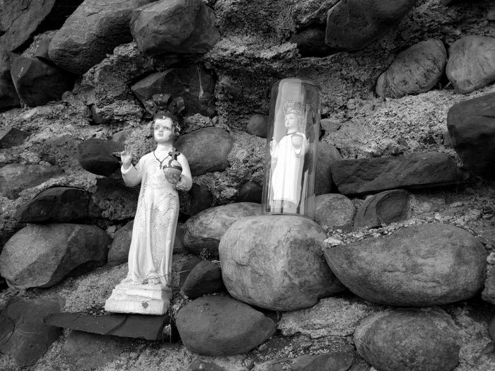 Large Group Of Objects Stack Stone - Object Religious Icons Stone Wall Background Black And White Infant Of Prague Glass Bubble Tourist_spot stone material stone no people Baby Jesus