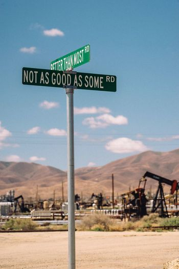 At the crossroads Patriotism America Truth Signage Crossroads Communication Sign Text Sky Western Script No People Guidance Road Day Cloud - Sky Fuel And Power Generation Road Sign