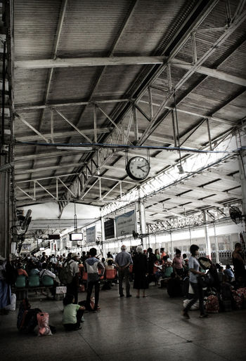 Adult Adults Only Black And White With A Splash Of Colour Ceiling Clock Clock Face Day Indoors  Indoors  Large Group Of People Men Only Men People Real People Train Station Waiting Waiting For A Train Yangon Train Station