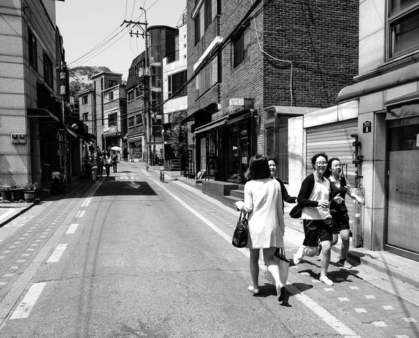 Asia, Korea, Seoul, Streets and People of Tongin Market Architecture Building Exterior Car City City Life City Street Incidental People Land Vehicle Leading Narrow Perspective Road Sidewalk Street The Way Forward Transportation Urban Walking Women
